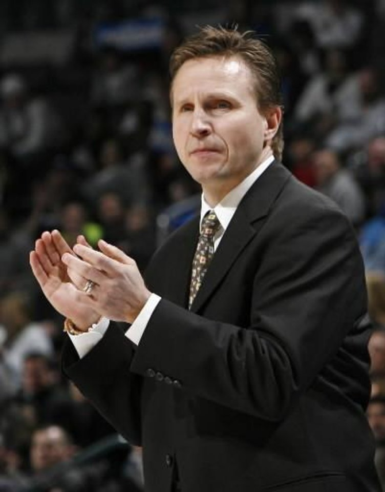 Oklahoma City head coach  Scott  Brooks claps after a play during the NBA basketball game between the Oklahoma City Thunder and the New Jersey Nets at the Ford Center in Oklahoma City, Monday, January 26, 2009. BY NATE BILLINGS