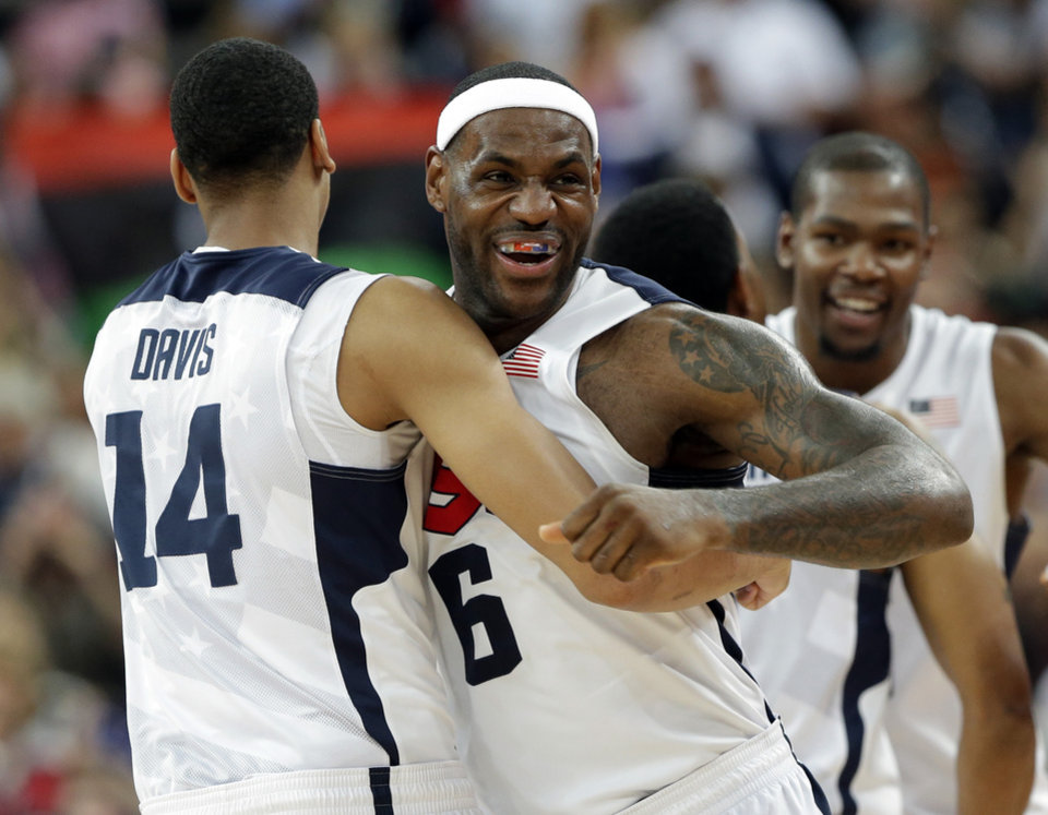 United States' LeBron James and Anthony Davis celebrate after the men's gold medal basketball game at the 2012 Summer Olympics, Sunday, Aug. 12, 2012, in London. USA won 107-100. (AP Photo/Eric Gay)