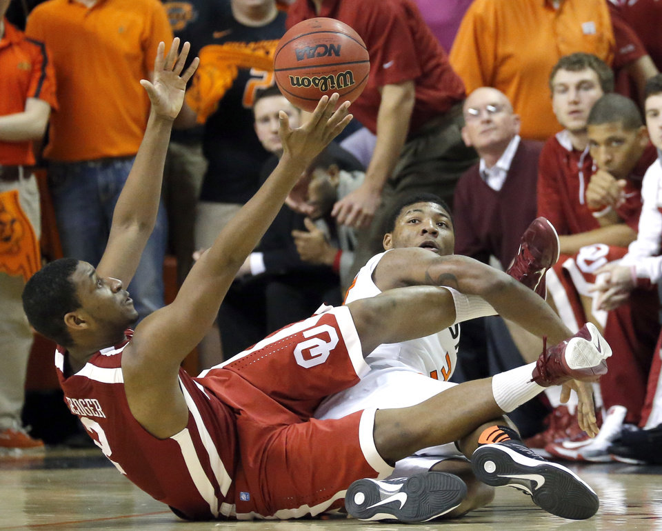 Oklahoma's Steven Pledger (2) and Oklahoma State's Marcus Smart (33) fight for a loose ball during the Bedlam men's college basketball game between the Oklahoma State University Cowboys and the University of Oklahoma Sooners at Gallagher-Iba Arena in Stillwater, Okla., Saturday, Feb. 16, 2013. Photo by Sarah Phipps, The Oklahoman