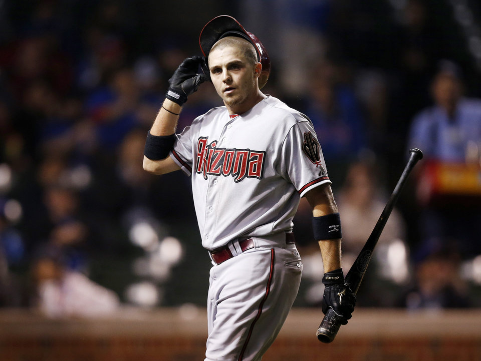 Photo - Arizona Diamondbacks' Tony Campana reacts after he struck out looking against the Chicago Cubs during the fifth inning of a baseball game on Monday, April 21, 2014, in Chicago. (AP Photo/Andrew A. Nelles)