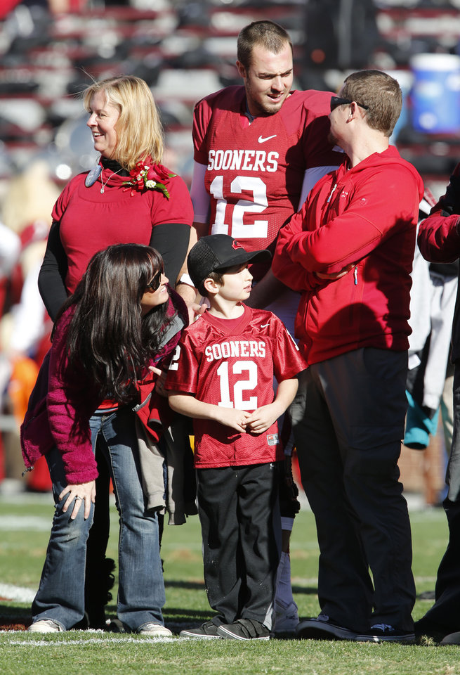Photo - Quarterback Landry Jones is introduced with his family on Senior Day before the Bedlam college football game between the University of Oklahoma Sooners (OU) and the Oklahoma State University Cowboys (OSU) at Gaylord Family-Oklahoma Memorial Stadium in Norman, Okla., Saturday, Nov. 24, 2012. Photo by Steve Sisney, The Oklahoman