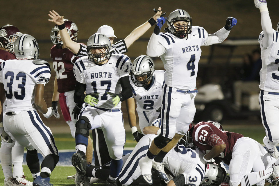 Photo - Edmond North celebrates a fumble recovery inside the 5 yard line during the high school football playoff game between Edmond North and Edmond Memorial at Watland Stadium in Edmond, Friday, November 15, 2013. Photo by Doug Hoke, The Oklahoman