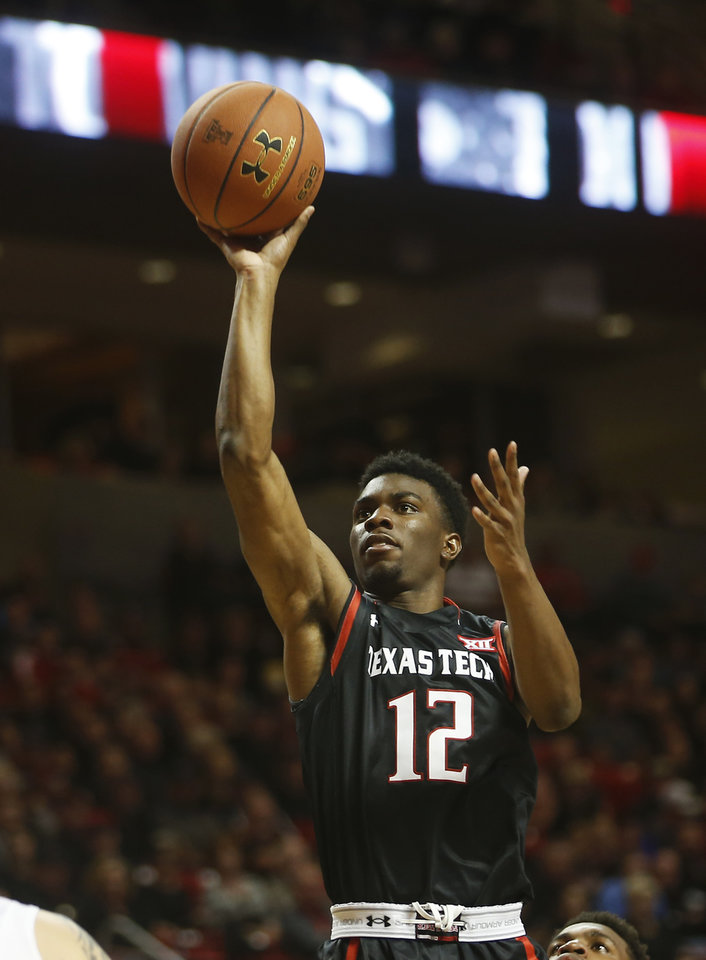 Photo - Texas Tech's Keenan Evans shoots the ball during the first half of an NCAA college basketball game against Oklahoma, Wednesday, Feb. 17, 2016 in Lubbock, Texas. (AP Photo/Brad Tollefson)