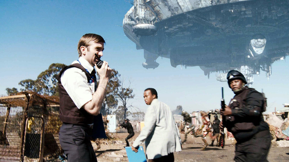 "Photo - From left, Sharlto Copley, Mandla Gaduka and Kenneth Nkosi share a scene in the sci-fi thriller ""District 9."" TRISTAR PICTURES PHOTO"