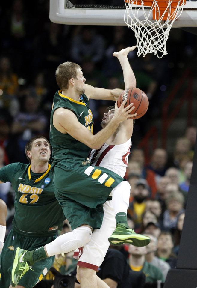 Photo - North Dakota State's Taylor Braun (24) shoots as Oklahoma's Ryan Spangler (00) defends during the NCAA men's basketball tournament game between the University of Oklahoma and North Dakota State at the Spokane Arena in Spokane, Wash., Thursday, March 20, 2014. Oklahoma home lost 80-75. Photo by Sarah Phipps, The Oklahoman
