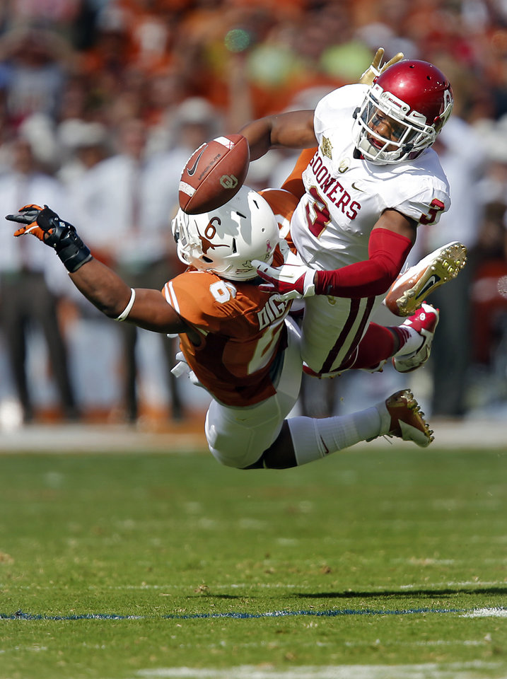 UT's Quandre Diggs (6) breaks up a pass for OU's Sterling Shepard (3) during the Red River Rivalry college football game between the University of Oklahoma Sooners (OU) and the University of Texas Longhorns (UT) at the Cotton Bowl Stadium in Dallas, Saturday, Oct. 12, 2013. Photo by Chris Landsberger, The Oklahoman