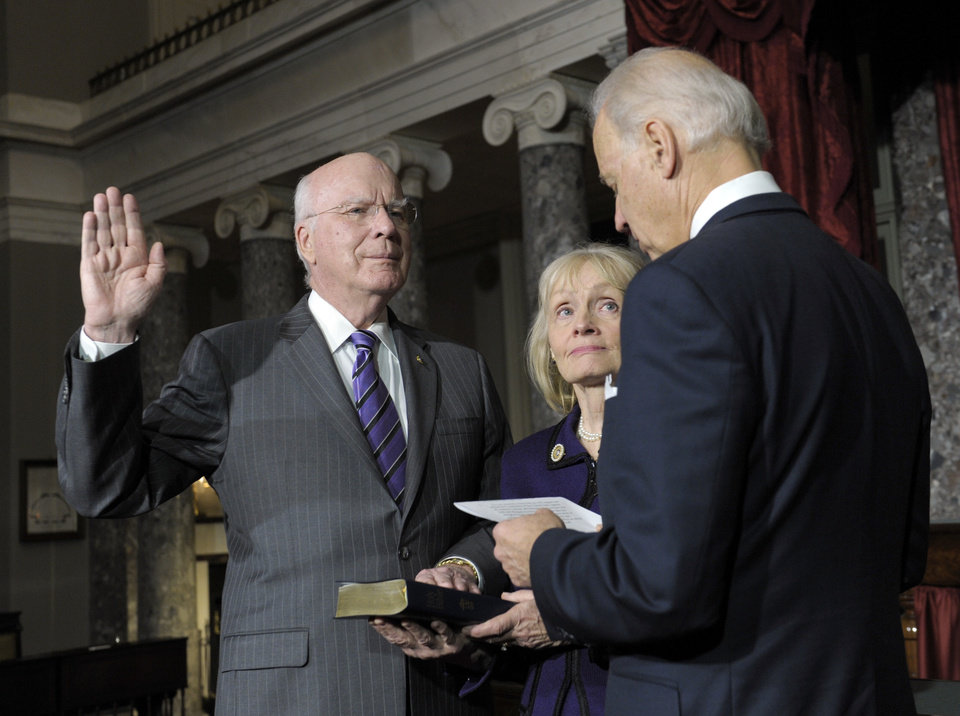Photo - Vice President Joe Biden, right, reenacts the swearing in of Sen. Patrick Leahy, D-Vt., as President Pro Tempore of the Senate on Capitol Hill in the Old Senate Chamber in Washington, Tuesday, Dec. 18, 2012. Leahy's wife, Marcelle Pomerleau, watches from the middle. (AP Photo/Susan Walsh)