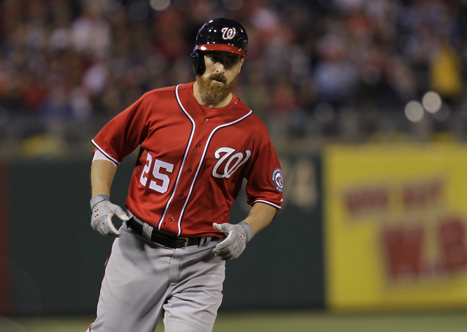 Photo - Washington Nationals' Adam LaRoche runs the bases after hitting a home run in the sixth inning of a baseball game against the Philadelphia Phillies, Saturday, May 3, 2014, in Philadelphia. (AP Photo/Laurence Kesterson)
