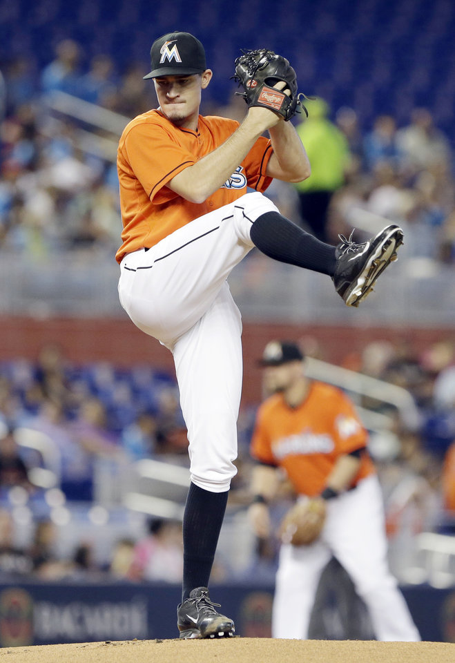 Photo - Miami Marlins' Andrew Heaney delivers a pitch during the first inning of a baseball game against the Oakland Athletics, Sunday, June 29, 2014 in Miami. (AP Photo/Wilfredo Lee)