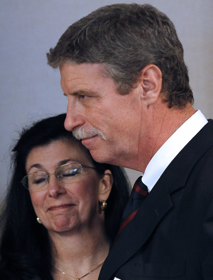 Jim Letten, U.S. Attorney for the Eastern District, announces his resignation during a news conference in New Orleans, Thursday, Dec. 6, 2012.  Letten said his resignation is effective Dec. 11 and that he plans to stay on with the department briefly to help with the transition in leadership.  Next to him is his wife JoAnn Letten. (AP Photo/Gerald Herbert)