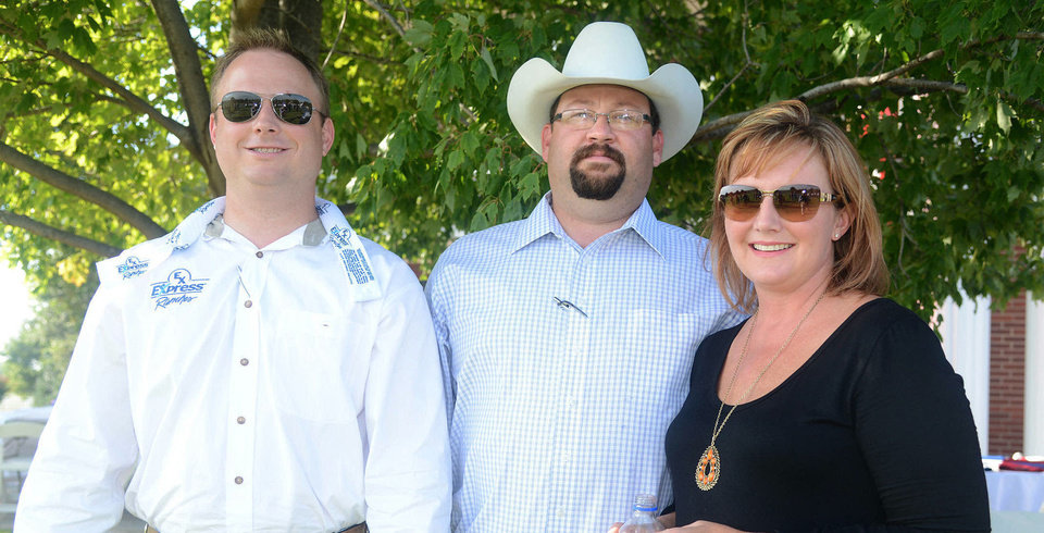 Photo - Lewis Cunningham, Brendon and Andrea Atkinson. Photo by David Faytinger, for the Oklahoman