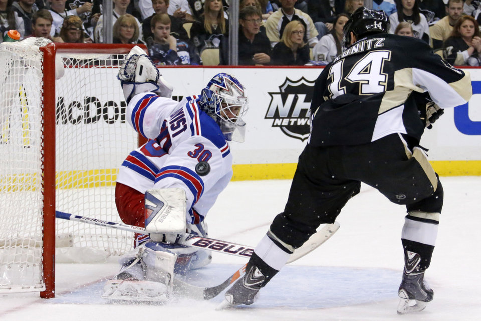 Photo - New York Rangers goalie Henrik Lundqvist (30) stops a shot by Pittsburgh Penguins' Chris Kunitz (14) in the second period of game 2 of a second-round NHL playoff hockey series in Pittsburgh Sunday, May 4, 2014. (AP Photo/Gene J. Puskar)