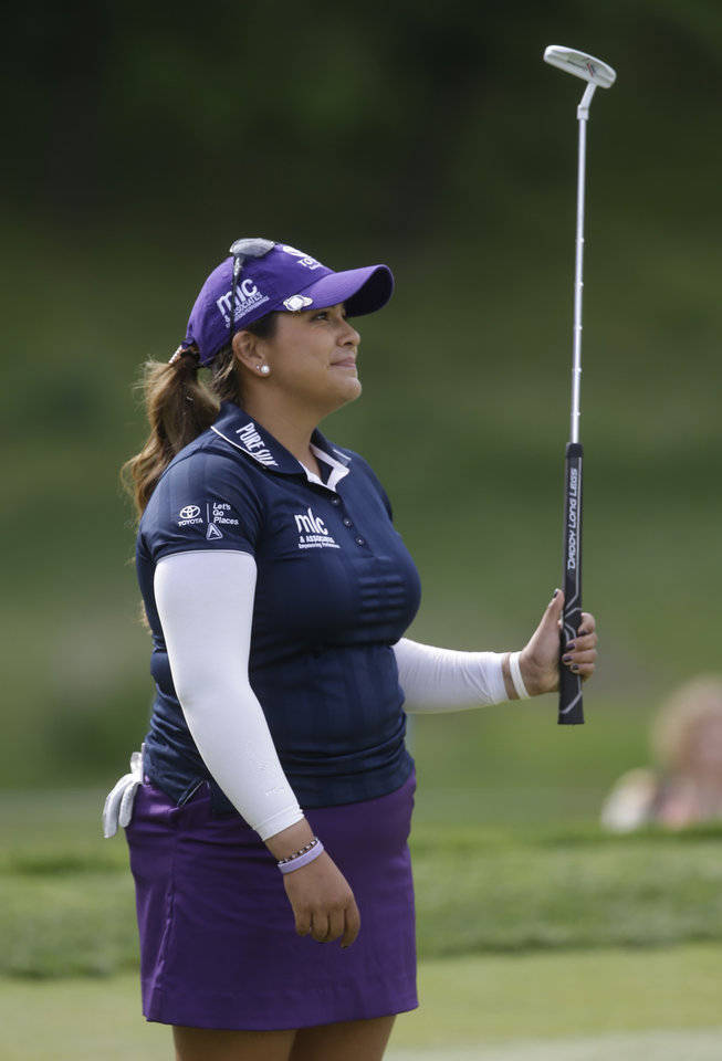 Photo - Lizette Salas reacts to a missed birdie on the ninth  hole during the final round of the Kingsmill Championship golf tournament at the Kingsmill resort  in Williamsburg, Va., Sunday, May 18, 2014.  Salas birdied the par-3 hole.  (AP Photo/Steve Helber)