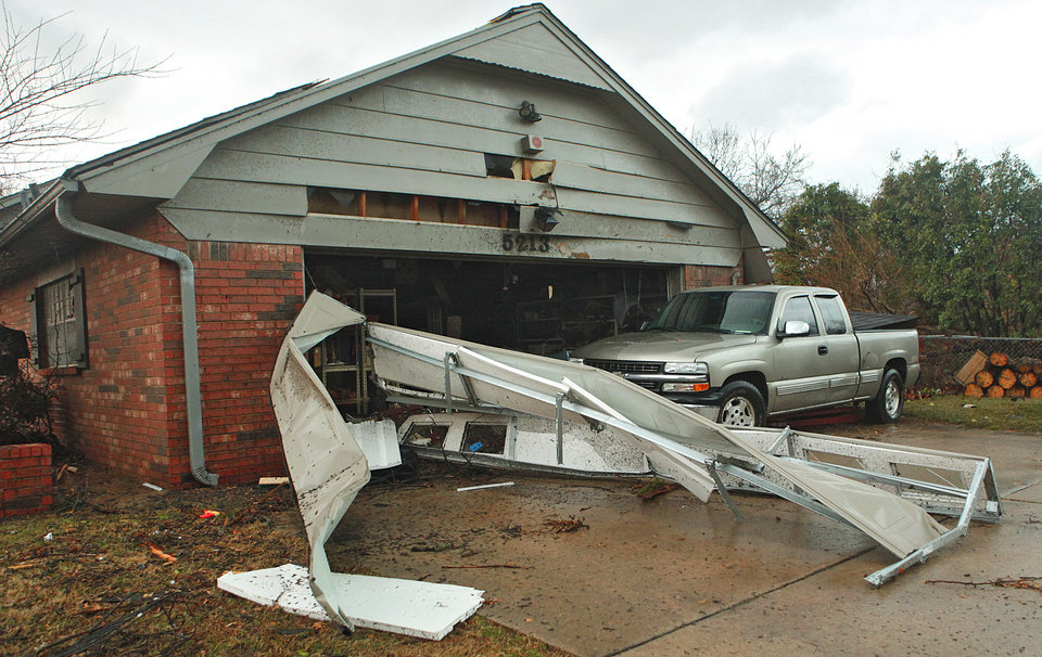 Photo - Damage to a house at 5213 Circle Glenn that was damage by the tornado that hit north Edmond on Tuesday, Feb. 10, 2009, in Edmond, Okla.  PHOTO BY CHRIS LANDSBERGER, THE OKLAHOMAN