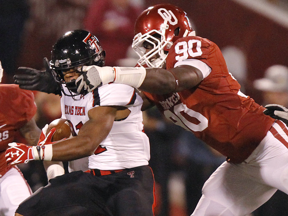 Photo - Oklahoma's David King (90) tries to stop Texas Tech's DeAndre Washington (21) during the college football game between the University of Oklahoma Sooners (OU) and Texas Tech University Red Raiders (TTU) at the Gaylord Family-Oklahoma Memorial Stadium on Saturday, Oct. 22, 2011. in Norman, Okla. Photo by Chris Landsberger, The Oklahoman