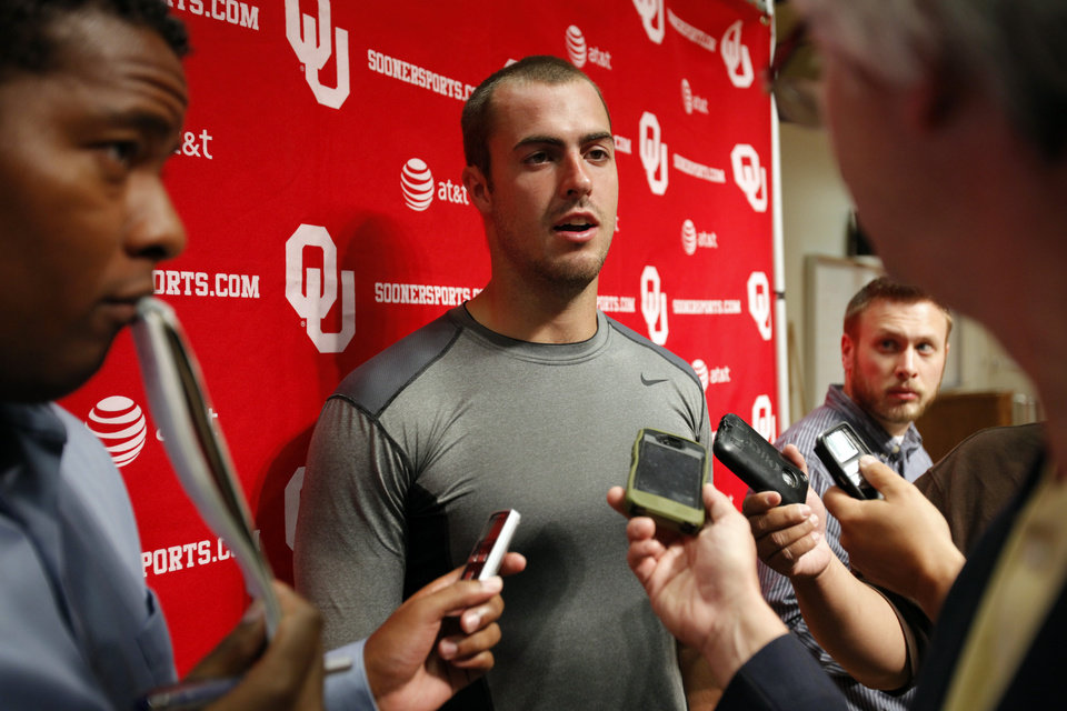 Photo - COLLEGE FOOTBALL / MUG: Landry Jones (12) speaks to the press at a media availability for the University of Oklahoma Sooner (OU) football team following practice on Tuesday, Aug. 21, 2012 in Norman, Okla.  Photo by Steve Sisney, The Oklahoman
