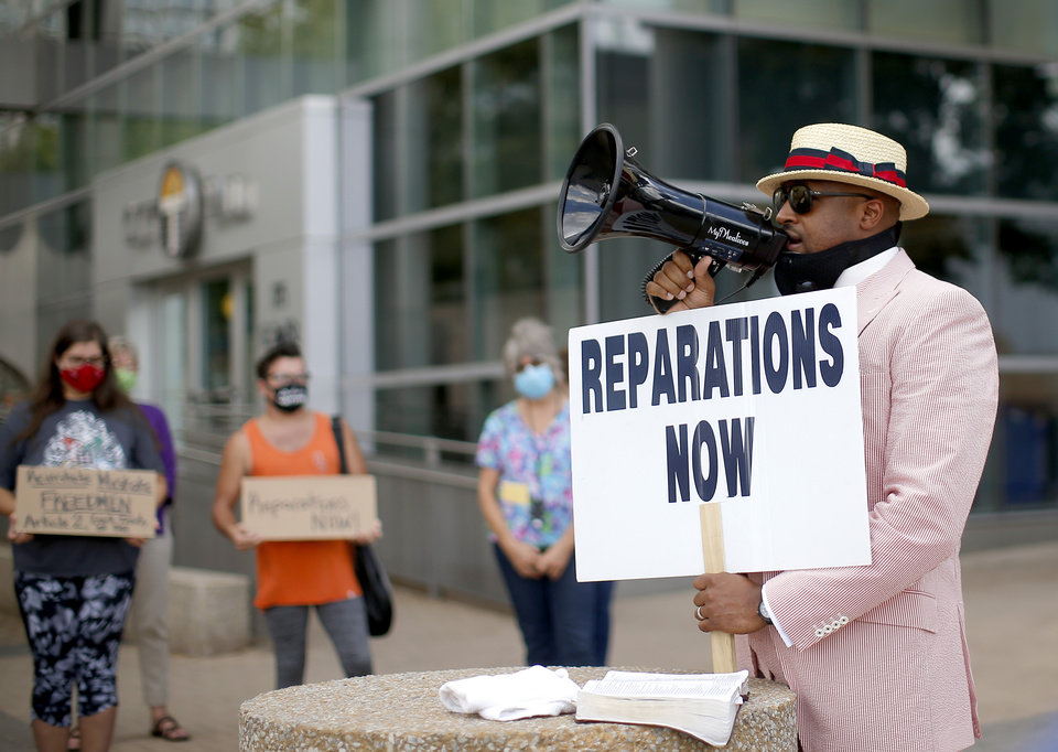 Photo - The Rev. Robert Turner protests for reparations for victims of the 1921 Tulsa Race Massacre at Tulsa City Hall, Wednesday, July 29, 2020, in Tulsa. Photo by Sarah Phipps, The Oklahoman
