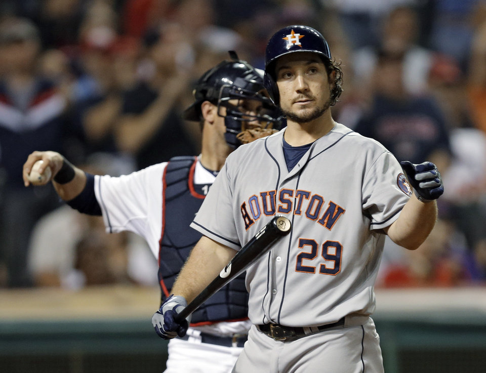 Houston Astros' Brett Wallace walks back to the dugout after striking out with the bases loaded against Cleveland Indians relief pitcher Chris Perez in the ninth inning of a baseball game Thursday, Sept. 19, 2013, in Cleveland. The Indians won 2-1 in 11 innings. (AP Photo/Mark Duncan)