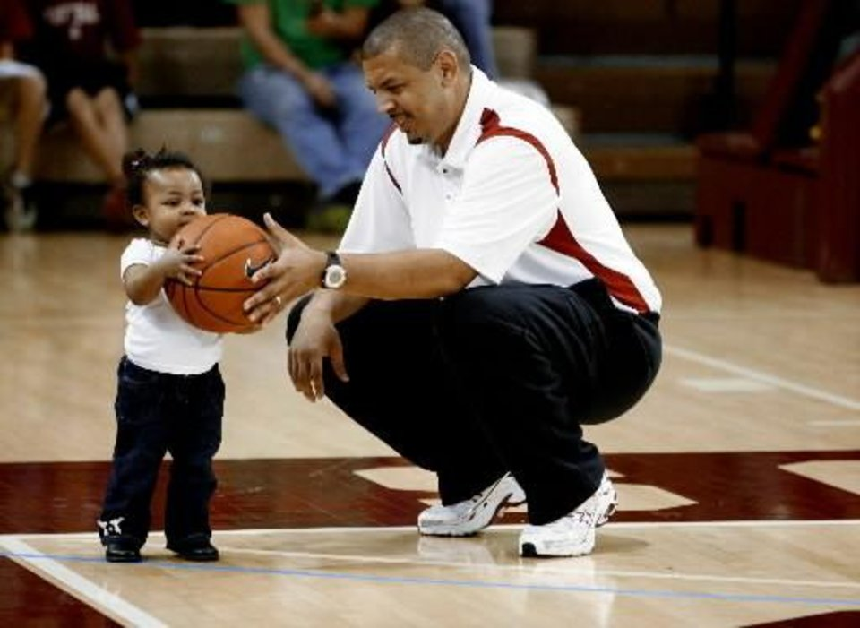 Head coach Jeff Capel and his daughter Cameron, 1, warm up before the University of Oklahoma Sooners (OU) men's college basketball scrimmage in McCasland Field House , on Saturday, Nov. 1, 2008, in Norman, Okla. BY STEVE SISNEY, THE OKLAHOMAN