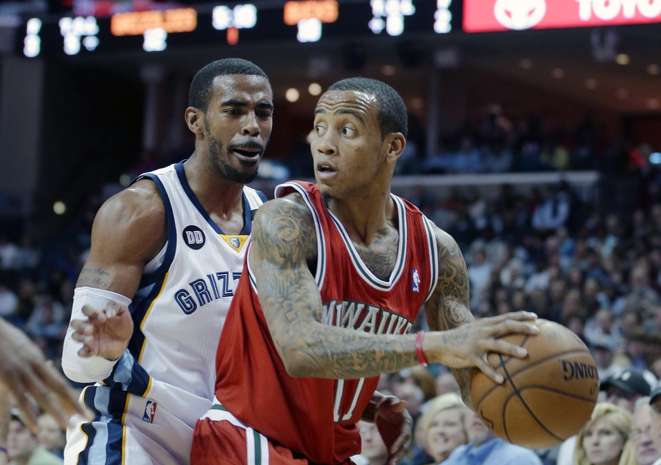 Photo - Milwaukee Bucks' Monta Ellis (11) is pressured by Memphis Grizzlies' Mike Conley during the first half of an NBA basketball game in Memphis, Tenn., Wednesday, Dec. 19, 2012. (AP Photo/Danny Johnston)