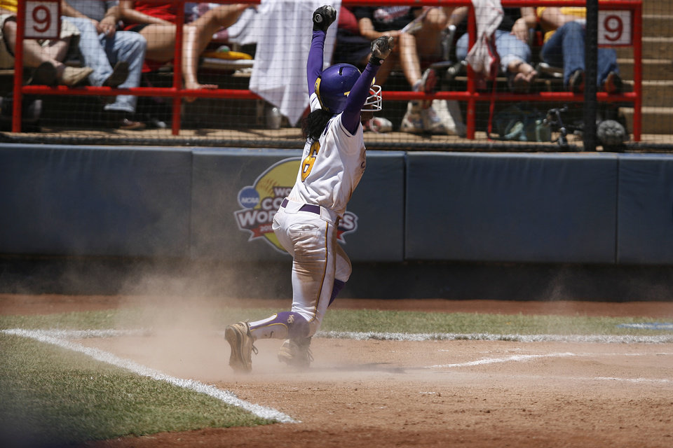 LSU's A.J. Andrews (6) celebrates after sliding into home during a Women's College World Series game between Louisiana State University and the University of South Florida at ASA Hall of Fame Stadium in Oklahoma City, Saturday, June 2, 2012.  Photo by Garett Fisbeck, The Oklahoman
