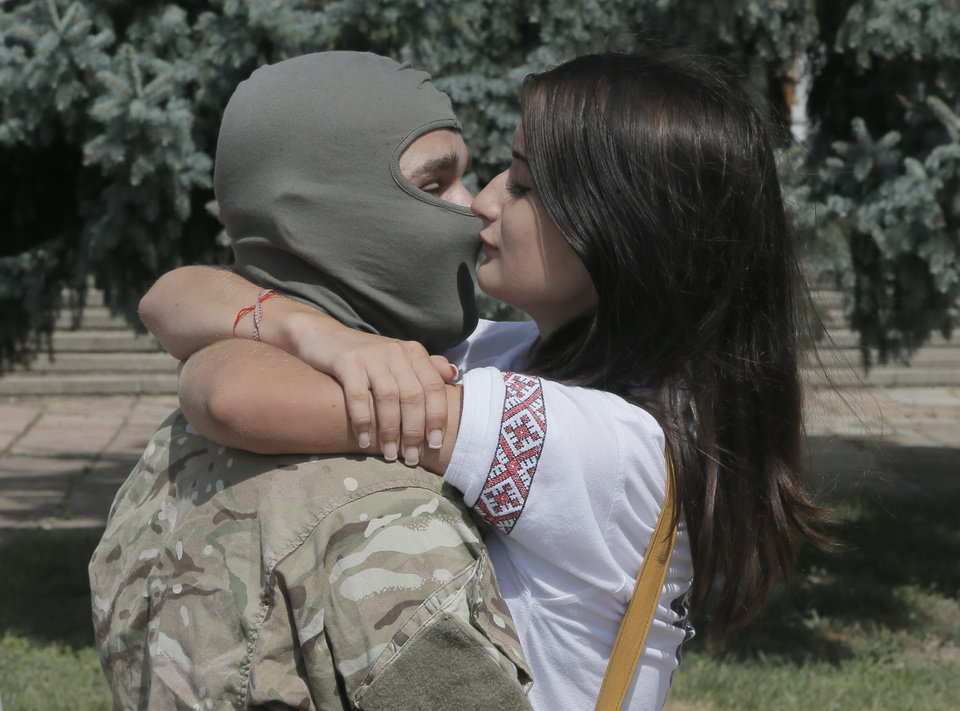 Photo - A couple shares the last kiss as they say goodbye to each other before volunteers were sent to the eastern part of Ukraine to join the ranks of special battalion