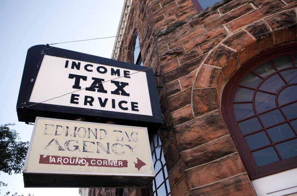 Photo - An income tax service and the Edmond Tag Agency are also tenants of the oldest commercial building in Oklahoma county, built in 1893 and located at 101 S Broadway in Edmond. June 10, 2013. Photo by KT KING, The Oklahoman