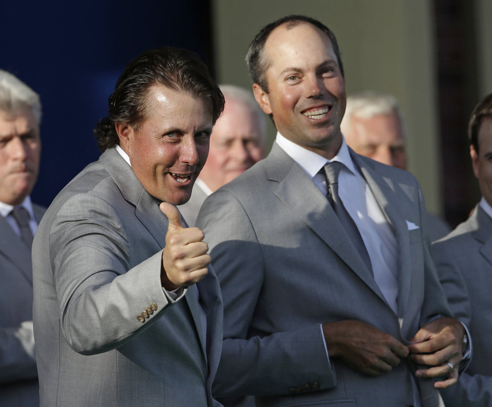 Photo -   USA's Matt Kuchar, right, watches as Phil Mickelson is introduced during the opening ceremony at the Ryder Cup PGA golf tournament Thursday, Sept. 27, 2012, at the Medinah Country Club in Medinah, Ill. (AP Photo/Chris Carlson)