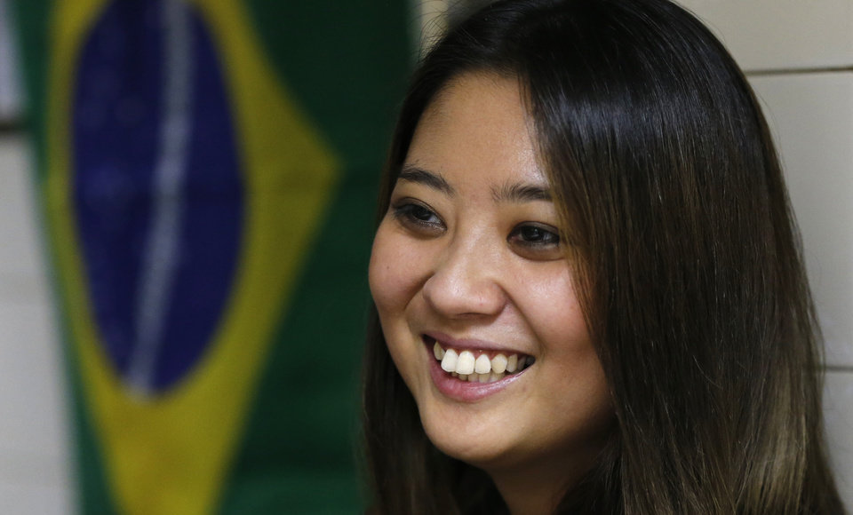 Photo - In this June 10, 2014, photo, Sao Paulo's former Miss Okinawa, Lais Miwa Higa, speaks during an interview at Bar Kintaro in Sao Paulo, Brazil. The elite Sao Paulo University Master's degree student in anthropology, who is considering a PhD, has trouble being perceived among Brazilian peers as more than a Japanese geisha doll. (AP Photo/Shuji Kajiyama)