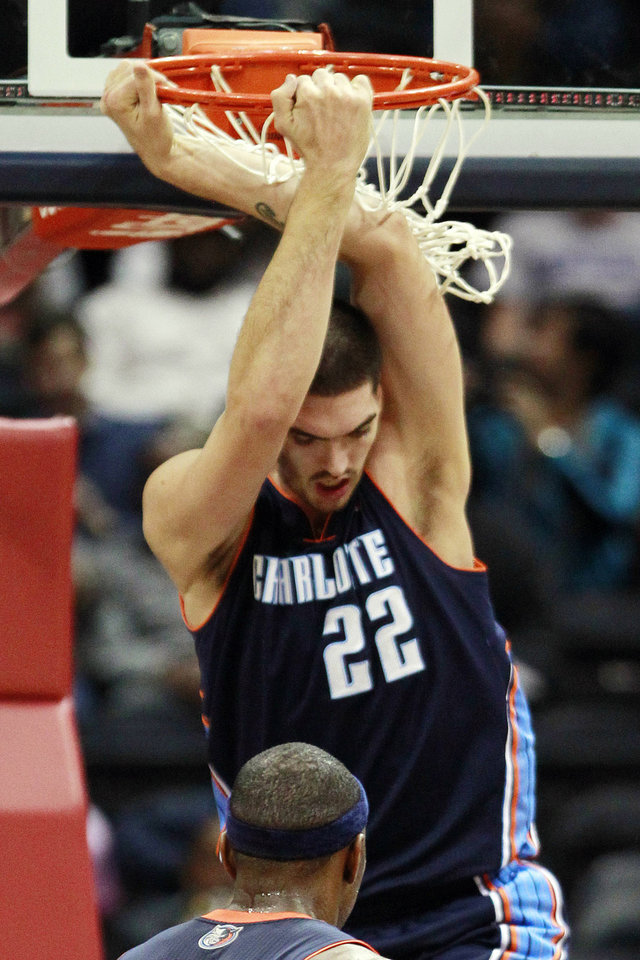 Charlotte Bobcats center Byron Mullens (22) dunks against the Atlanta Hawks in the first half of an NBA basketball game, Wednesday, Nov. 28, 2012, in Atlanta. (AP Photo/John Bazemore)