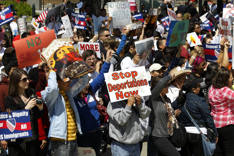 Supporters of immigrant rights rally at the Supreme Court in Washington, Wednesday, April 25, 2012, as the court held a hearing on Arizona\'s
