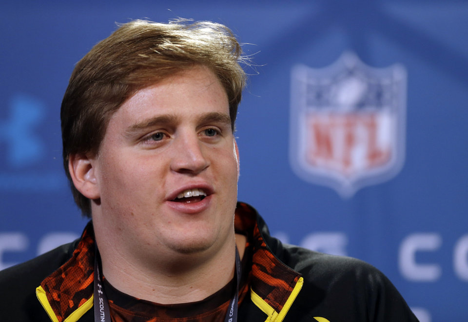 Photo - Alabama offensive lineman Barrett Jones answers a question during a news conference at the NFL football scouting combine in Indianapolis, Thursday, Feb. 21, 2013. (AP Photo/Michael Conroy)
