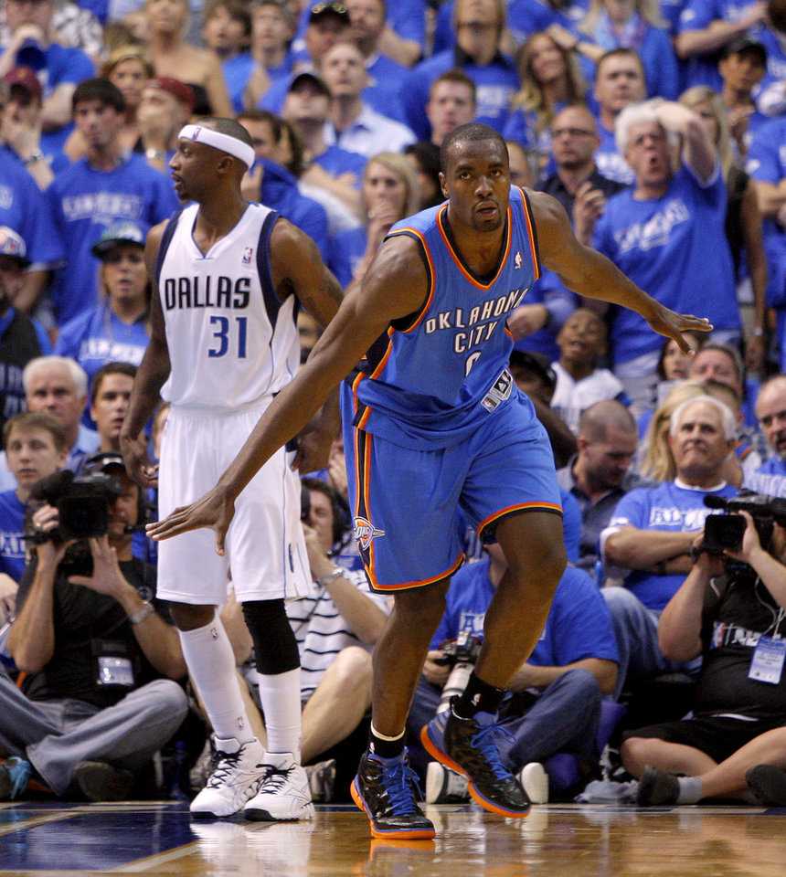 Oklahoma City's Serge Ibaka (9) celebrates beside Dallas' Jason Terry (31) during Game 4 of the first round in the NBA playoffs between the Oklahoma City Thunder and the Dallas Mavericks at American Airlines Center in Dallas, Saturday, May 5, 2012. Oklahoma City won 103-97. Photo by Bryan Terry, The Oklahoman