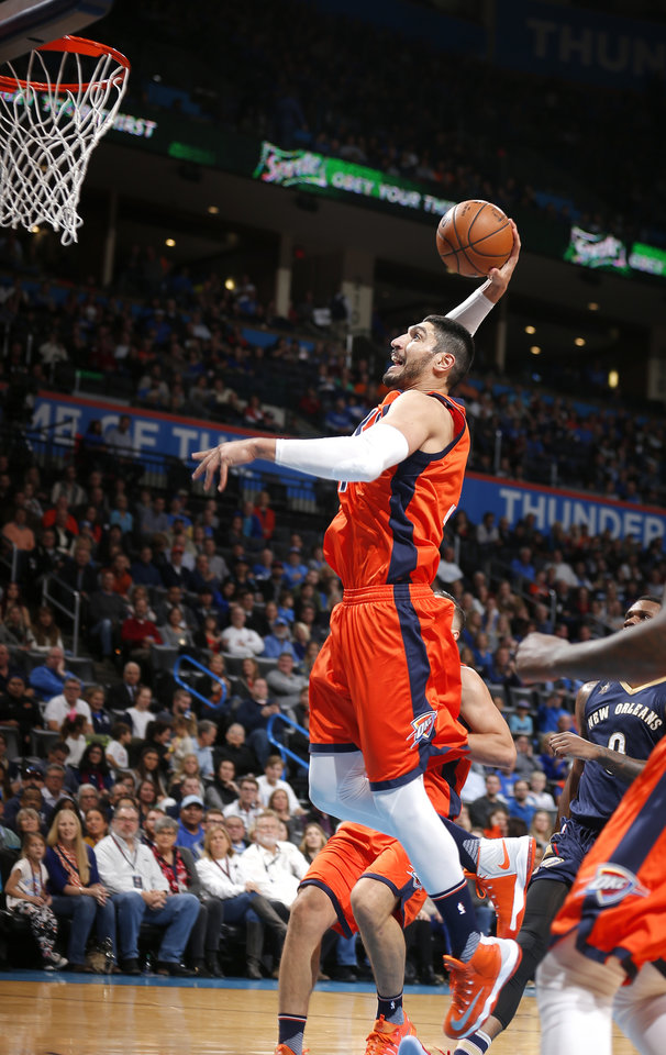 Photo - Oklahoma City's Enes Kanter (11) goes up for a dunk during the NBA game between the Oklahoma City Thunder and the New Orleans Pelicans at the Chesapeake Energy Arena,  Sunday, Dec. 4, 2016. Photo by Sarah Phipps, The Oklahoman