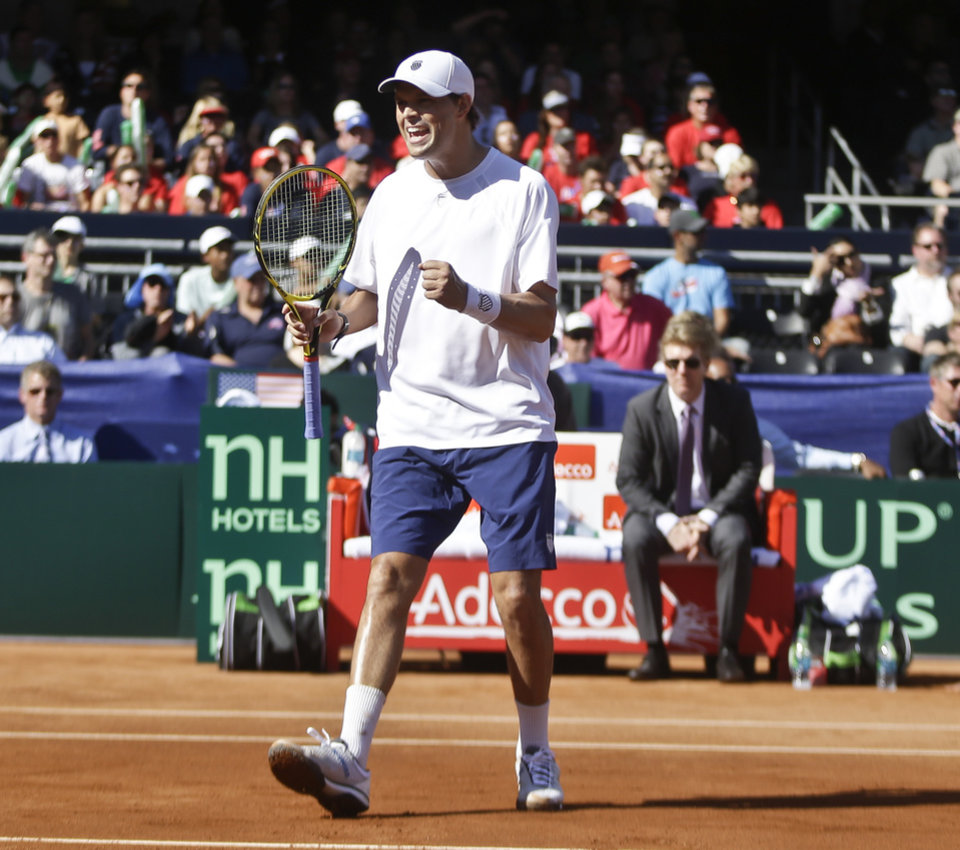Photo - Bob Bryan reacts to winning a point against the British team during a doubles match at the Davis Cup tennis matches, Saturday, Feb. 1, 2014, in San Diego. (AP Photo/Lenny Ignelzi)