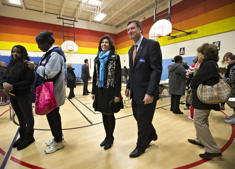 Virginia Republican senate candidate George Allen, joined by his wife Susan, arrive to vote in their home precinct in the Mount Vernon area of Fairfax County, Va., Tuesday, Nov. 6, 2012. (AP Photo/J. Scott Applewhite)