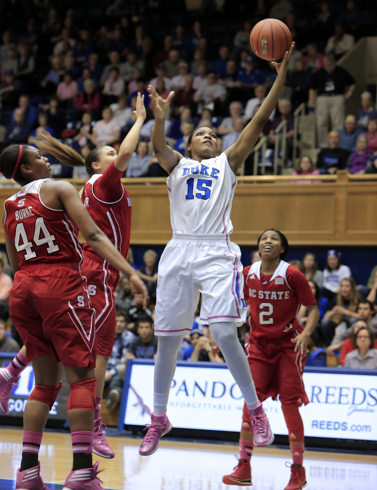Photo - Duke's Richa Jackson shoots near NC State's Kody Burke (44), Len'Nique Brown (2) and Miah Spencer during the first half of an NCAA college basketball game in Durham, N.C., Thursday, Feb. 20, 2014.  (AP Photo/Ted Richardson)