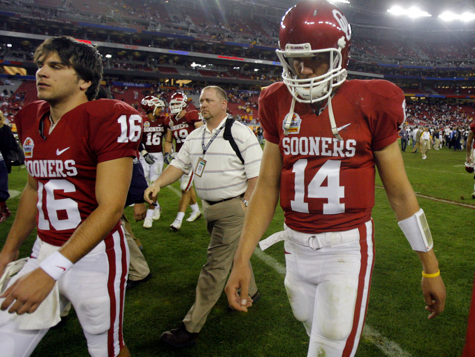 Photo - Sam Bradford (14) walks off the field after the 48-28 loss to West Virginia during the Fiesta Bowl college football game between the University of Oklahoma Sooners (OU) and the West Virginia University Mountaineers (WVU) at The University of Phoenix Stadium on Wednesday, Jan. 2, 2008, in Glendale, Ariz. 