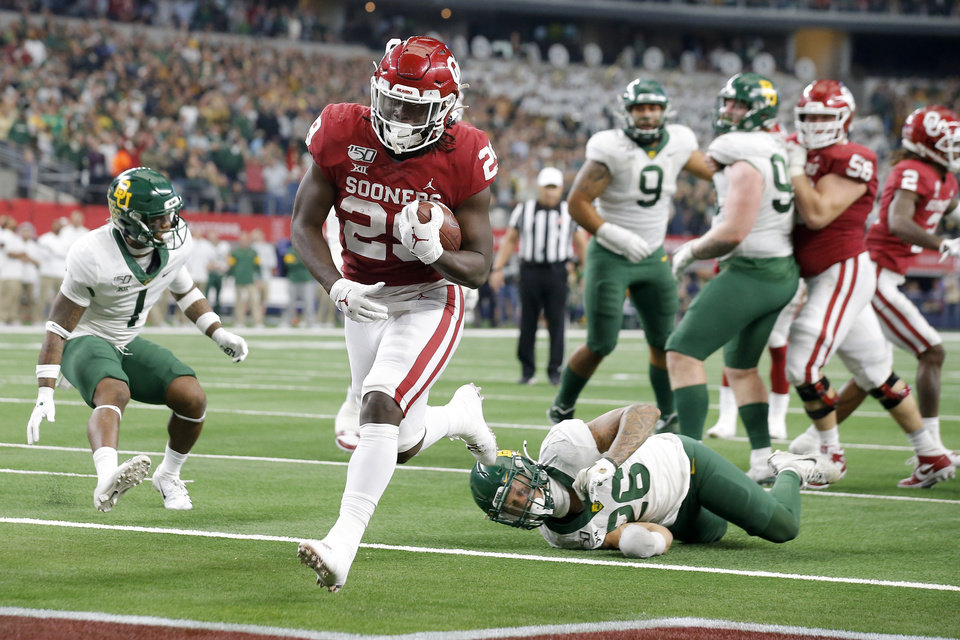 Photo - Oklahoma's Rhamondre Stevenson (29) scores a touchdown past Baylor's Terrel Bernard (26) in overtime of the Big 12 Championship Game between the University of Oklahoma Sooners (OU) and the Baylor University Bears at AT&T Stadium in Arlington, Texas, Saturday, Dec. 7, 2019. Oklahoma won 30-23. [Bryan Terry/The Oklahoman]