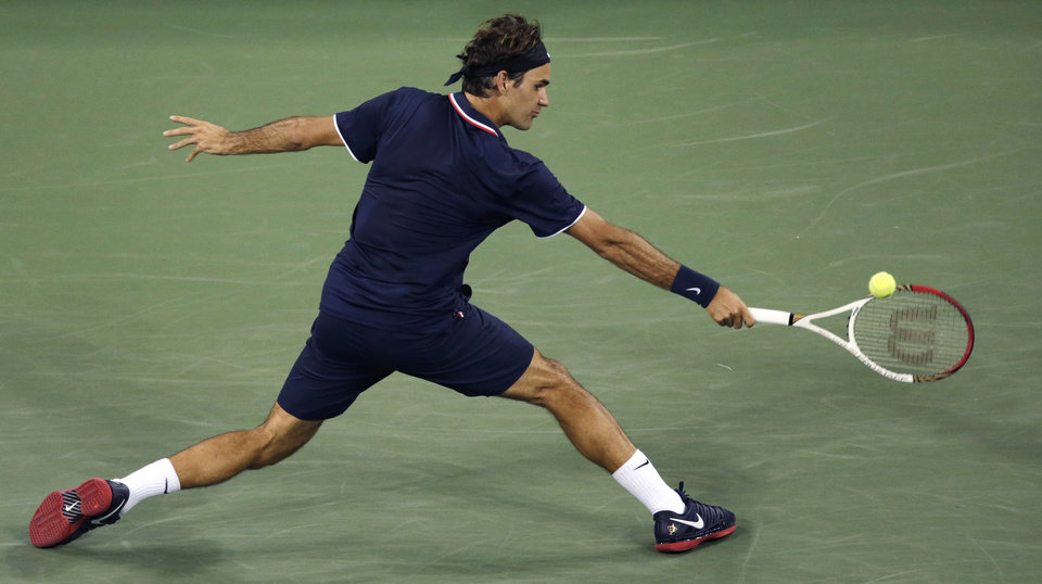 Photo -   Roger Federer, of Switzerland, stretches for a return to Tomas Berdych, of the Czech Republic, during a quarterfinal at the U.S. Open tennis tournament, Wednesday, Sept. 5, 2012, in New York. (AP Photo/Charles Krupa)
