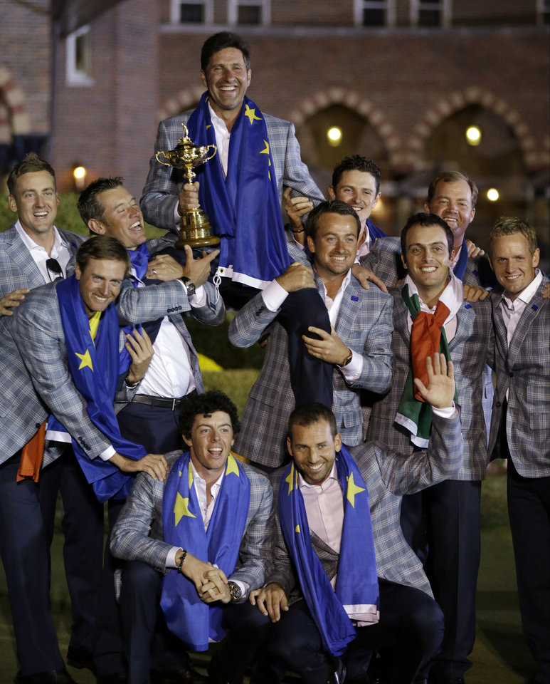 The European team posses with the trophy after winning the Ryder Cup PGA golf tournament Sunday, Sept. 30, 2012, at the Medinah Country Club in Medinah, Ill. (AP Photo/David J. Phillip)  ORG XMIT: PGA272