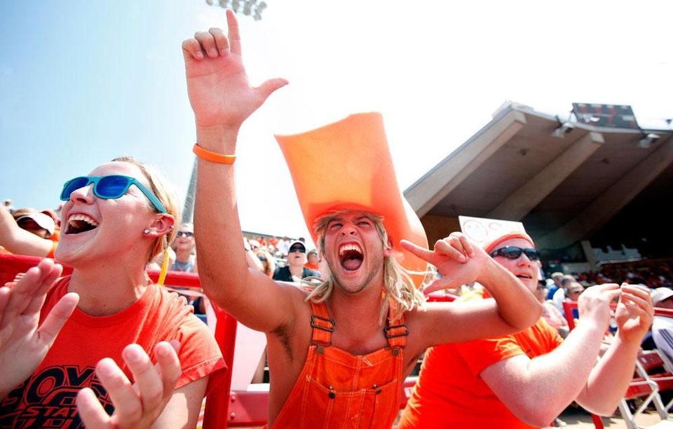 Photo -  OSU fans Megan Castle and Copan Combs cheer on the Cowgirls during the Women's College World Series game between Oklahoma State University and Baylor at the ASA Hall of Fame Stadium in Oklahoma City, Thursday, June 2, 2011. Photo by Sarah Phipps, The Oklahoman