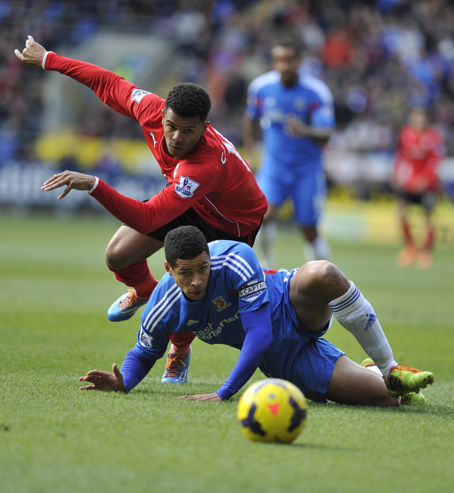 Photo - Cardiff City's Fraizer Campbell and Hull City's Curtis Davies (front)  during their English  Premier League match, at The Cardiff City Stadium, Cardiff,  Wales,  Saturday Feb. 22, 2014. (AP Photo/PA) UNITED KINGDOM OUT: NO SALES: NO ARCHIVE