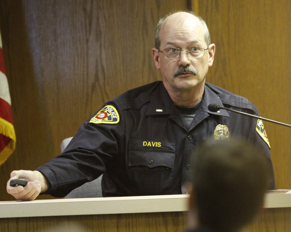 Photo - Mustang police Lt. James Davis appears on the witness stand Wednesday, May 8, 2013, during Rebecca Bryan's murder trial in the Canadian County Courthouse in El Reno. Bryan is accused of killing her husband, Keith Bryan, 52, who was the Nichols Hills fire Chief. Photo By Steve Gooch, The Oklahoman  Steve Gooch - The Oklahoman