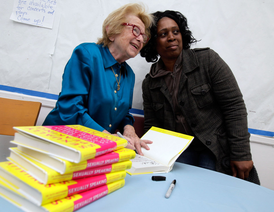 Photo -   In this Thursday, April 26, 2012 photo, Dr. Ruth Westheimer poses for a photo with a fan as she signs a copy of her book at the National Council of Jewish Women in New York. In 1980, Westheimer broke into late-night radio with