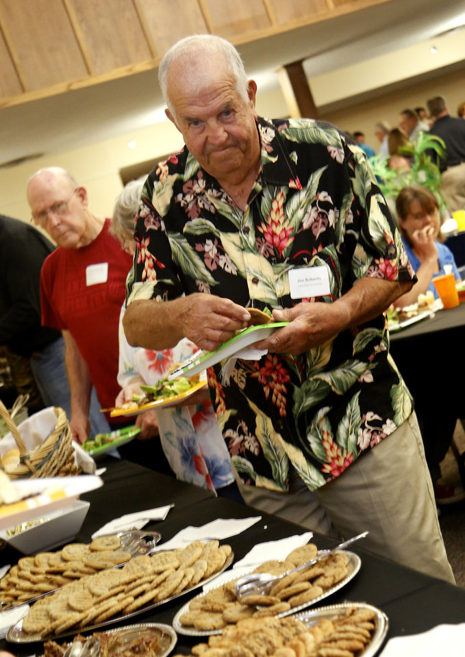 Jim Roberts, chairman of the Edmond Fish and Game Commission, goes through the food line at the annual appreciation dinner for Edmond employees and members of boards and commissions.