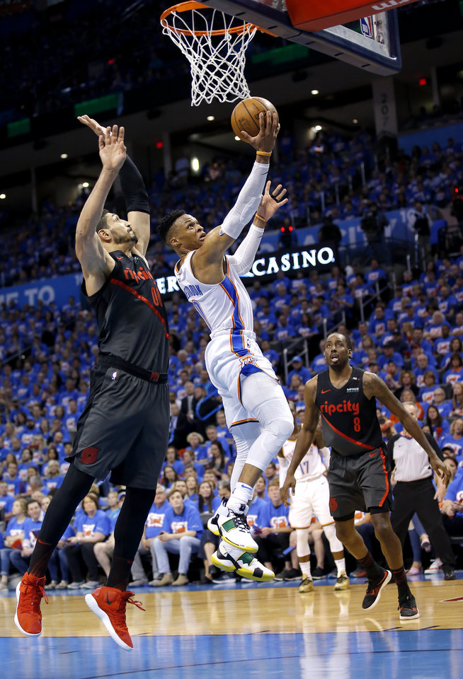 Photo - Oklahoma City's Russell Westbrook (0) goes up for a basket as Portland's Enes Kanter (00) defends during Game 4 in the first round of the NBA playoffs between the Portland Trail Blazers and the Oklahoma City Thunder at Chesapeake Energy Arena in Oklahoma City, Sunday, April 21, 2019.  Photo by Sarah Phipps, The Oklahoman