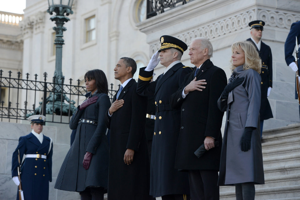 Photo - President Barack Obama, first lady Michelle Obama, Vice President and Mrs. Biden and Maj. Gen. Michael S. Linnington, participate in the review of the troops on Capitol Hill in Washington, Monday, Jan. 21, 2013, following the president's ceremonial swearing-in ceremony during the 57th Presidential Inauguration. (AP Photo/Washington Post, Linda Davidson, Pool) ORG XMIT: DCWAP103