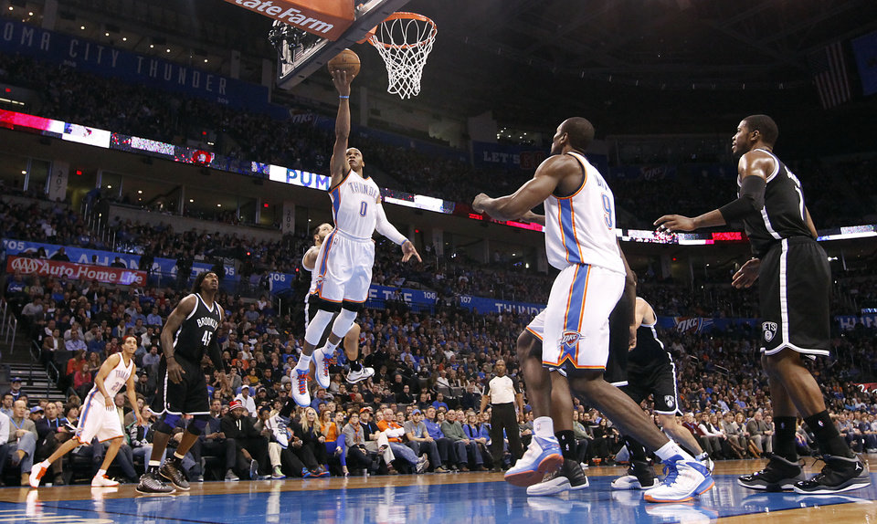 Photo - Oklahoma City's Russell Westbrook (0) drives to the basket for a layup during the NBA basketball game between the Oklahoma City Thunder and the Brooklyn Nets at the Chesapeake Energy Arena on Wednesday, Jan. 2, 2013, in Oklahoma City, Okla. Photo by Chris Landsberger, The Oklahoman