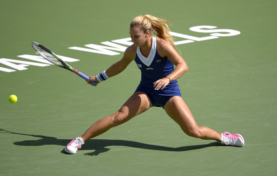 Photo - Dominika Cibulkova, of Slovakia, reaches for a hit from Li Na, of China, during a quarterfinal match at the BNP Paribas Open tennis tournament, Thursday, March 13, 2014 in Indian Wells, Calif. (AP Photo/Mark J. Terrill)